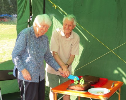 Cutting the cake marking 50 Summer camps